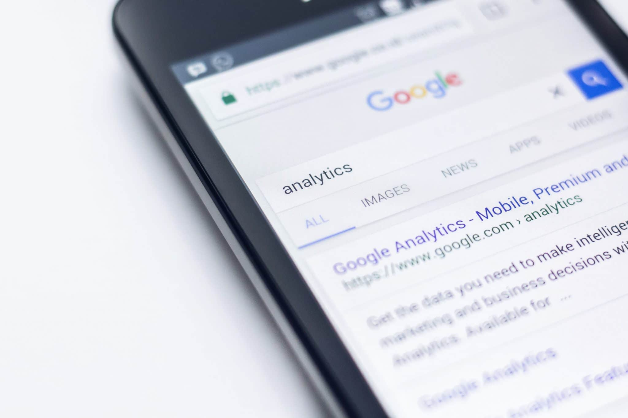 an iPhone showing a google search for the term analytics